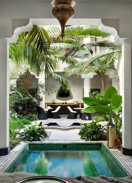 copper and gold Lanterns and luscious plants and mosaicsfor a morrocan vibe